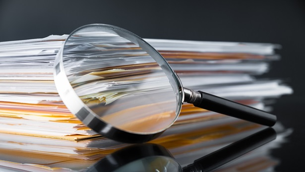 Magnifying glass in front of documents
