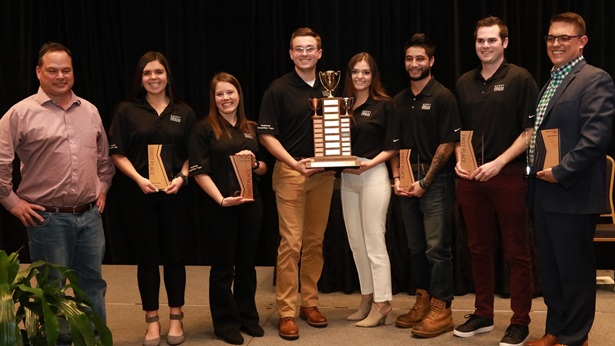 Students from Michigan State accept the award for the 2019 Four Year programs student competition
